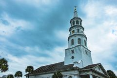 View of St. Michaels church bell tower in Charleston, South Carolina with cloudy sky. Bell tower of main church of charleston, south carolina royalty free stock image