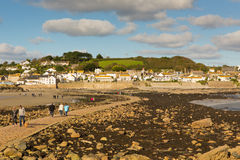 View from St Michaels Mount to Marazion Cornwall with people crossing the causeway Stock Image