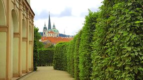 View of St Nicolas church taken from Wallenstein Garden in Prague, Czech Republic stock photo