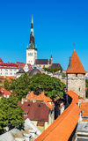 View of St. Olaf Church and city walls of Tallinn Royalty Free Stock Photo