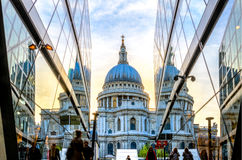 View of St Paul's Cathedral from One New Change. London, England - April 20, 2016 - View of St Paul's Cathedral from the One New Change building. Blue orange sky stock photography