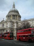 View of St Pauls Cathedral London England. Showing dome and London buses Royalty Free Stock Photo