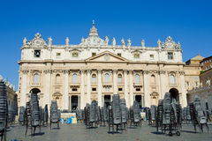 View of St Peter cathedral with empty chairs on the place Stock Photo