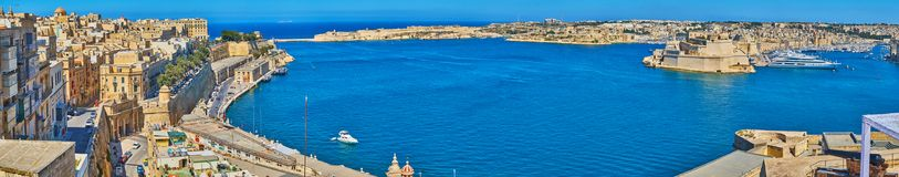 The medieval cities of Valletta Grand Harbour, Malta. The view from St Peter and Paul Bastion on azure waters of Grand Harbour, medieval quarters of Valletta Stock Photography