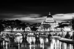 View at St. Peter`s cathedral in Rome, Italy. Night view of old roman Bridge of Hadrian and St. Peter`s cathedral in Vatican City Rome Italy Royalty Free Stock Image