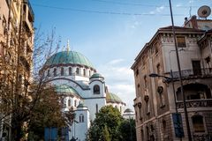 View of St. Sava cathedral through city street stock image