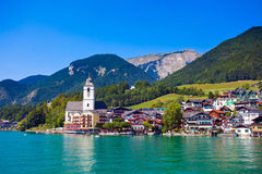 View of St. Wolfgang chapel. View of View of St. Wolfgang chapel and the village waterfront at Wolfgangsee lake, Austria Royalty Free Stock Photos