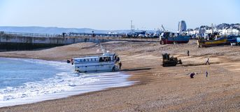 Hastings, East Sussex, England. A fishing boat returns with the catch of the day stock photo