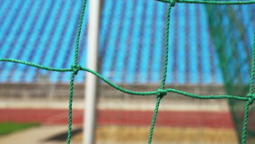 View of the stadium through the net of football gate stock video footage