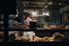 View of staff and visitors in an old bakery boulangerie in the Lille city centre. To be called a boulangerie, a French bakery must bake bread on the premises Stock Images