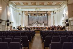 View of the stage of the concert hall at the Cracow Philharmonic with the new Orgelbau organ in the background. Cracow Stock Photos