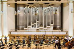 View of the stage of the concert hall at the Cracow Philharmonic with the new Orgelbau organ in the background. Cracow Stock Image