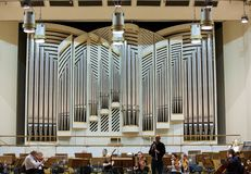 View of the stage of the concert hall at the Cracow Philharmonic with the new Orgelbau organ in the background. Cracow Stock Images