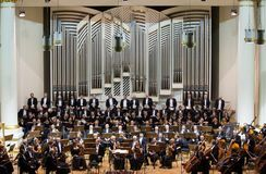 View of the stage of the concert hall at the Cracow Philharmonic with the new Orgelbau organ in the background. Cracow Royalty Free Stock Image