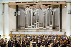 View of the stage of the concert hall at the Cracow Philharmonic with the new Orgelbau organ in the background. Cracow, Stock Photo