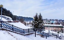 View from stairs sanatorium `Rodnik Altai` to the resort town of Belokurikha in winter, Altai Stock Photos