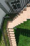 View of stairs step down against green lawn Stock Photo