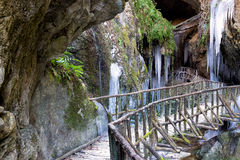 View of stalactites and stalagmites of ice at the entrance of a cave. Unusual view of stalactites and stalagmites of ice at the entrance of a cave royalty free stock images