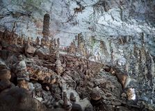 View of stalactites and stalagmites in an underground cavern - Postojna cave in Slovenia.  stock photography