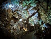 View of stalactites and stalagmites in an underground cavern - Postojna cave in Slovenia.  stock photo