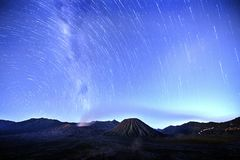 View of a star trails on the night sky. royalty free stock images