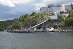 View of Statoil facility, Stockholm, Sweden. View of Statoil facility Skönviksvägen 2, 131 49 Nacka, Sweden from the sea. August 2016 Royalty Free Stock Photo
