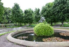 View on statue and fountain in stadpark Stock Image
