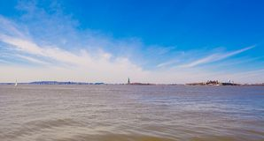 View of the statue of liberty from Battery Park Stock Images
