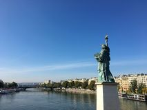Statue of liberty Paris France. View on Statue of liberty and Seine river on ile aux cygnes swan island Paris France royalty free stock photography