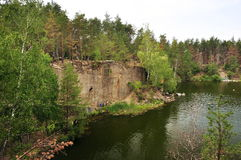 View of the steep bank of the lake, climbers Stock Image
