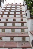 Hand painted tiles on steps stock photos