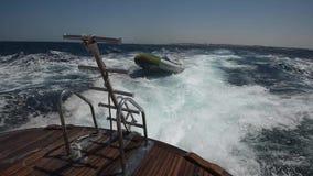View from stern on board a luxury motor yacht across tropical ocean stock video