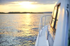 View from the stern of the boat at sunset. Handrails and the side of the boat stock photos