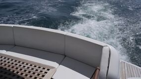 View from the stern of the motor yacht floating on the sea