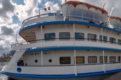Stern of river cruise ship with lifeboats. View of stern of river cruise ship with lifeboats stock images