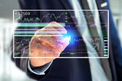 Stock exchange trading data information displayed on a futuristi Stock Photo