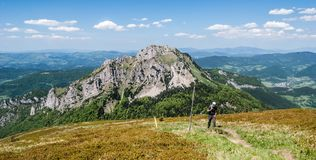 View from Stoh hill in Mala Fatra mountains in Slovakia. With nearest rocky Velky Rozsutec hill and many other hills during nice day with blue sky and only few royalty free stock images
