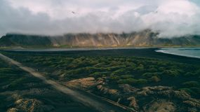 View of stokksnes and vestrahorn covered in clouds in iceland royalty free stock images