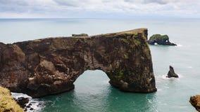 View stone arch on Dyrholaey peninsula in Iceland. Travel to Iceland - view of stone arch on Dyrholaey peninsula, near Vik I Myrdal village on Atlantic South stock photography