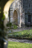 View through stone archway into beautiful medieval landscape gar Royalty Free Stock Images