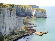 View of stone english channel shore on Etretat Stock Images
