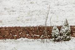 View of stone fence on field wintertime Royalty Free Stock Photos