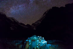 View of Stone rural Building in Nepal Mountains at Night. View of Stone rural Building in Nepal Mountains at Nigh and Night starry Sky rocky Ridges on Background Stock Photos