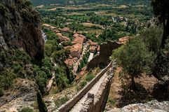 View of stone staircase, roofs and belfry under sunny blue sky in the charming village of Moustiers-Sainte-Marie. Royalty Free Stock Photography