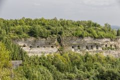 View of a stone wall and windows in a nature reserve of Sint-Pietersberg stock photo