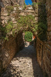 View of stone walls and arch in a alley under blue sky at Les Arcs-sur-Argens. View of stone walls and arch in a alley under blue sky, at the gorgeous medieval Royalty Free Stock Photos