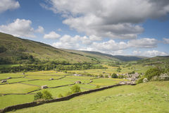 View of stone walls and meadows, Swaledale. Meadows, stone walls and barns, Gunnerside, Swaledale, Yorkshire Dales National Park Royalty Free Stock Photos
