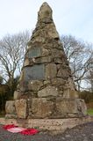 Bankfoot Memorial - monument of Remembrance, Perthshire. A view of a stone war memorial cairn in the rural Perthshire village of Bankfoot Royalty Free Stock Images