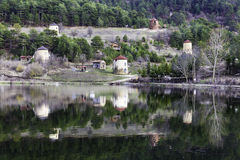 View of stone windmills and forest reflection on water by the Cubuk lake Royalty Free Stock Photography