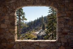 View Through a Stone Window. View of Yosemite National Park through the open stone window of a little hut Royalty Free Stock Photo